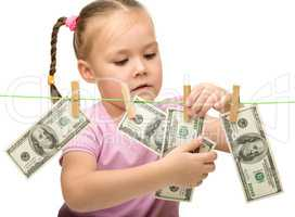 Cute little girl with paper money