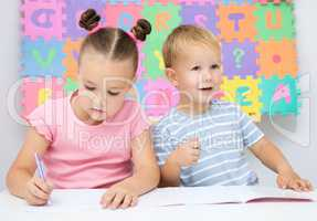 Children are writing on their books