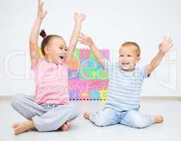 Children are sitting on floor