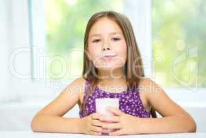 Cute little girl showing milk moustache