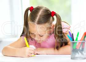 Cute cheerful child drawing using felt-tip pen