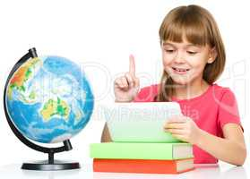 Young girl is using tablet