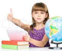 Little girl is using tablet