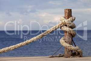 Rope on seafront and cloudy sky in autumn
