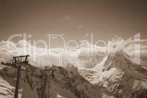 Sepia mountains and ski lift