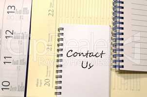 Contact us write on notebook