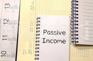 Passive income write on notebook