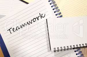 Teamwork write on notebook