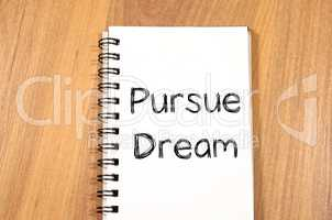 Pursue dream write on notebook