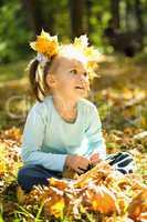 Portrait of a little girl in autumn park