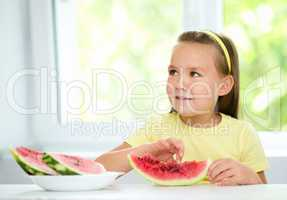 Little girl is eating watermelon