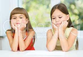 Portrait of two sad little girls