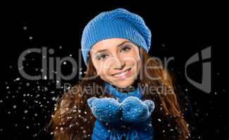Young happy woman under snowfall