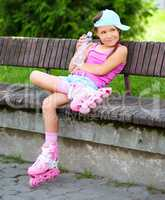 Little girl is wearing roller-blades