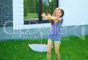 Happy girl is playing under rain