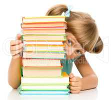 Little girl plays with book