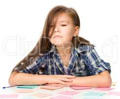 Girl is writing on color stickers