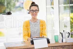 Hipster using type writer
