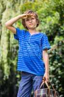 A little boy is looking the sky