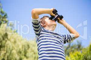 Low angle view of a child looking something with binoculars