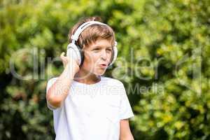 Child listening music with headphone