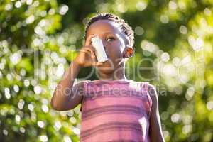 Boy using a asthma inhalator