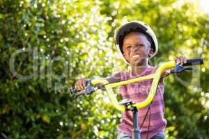 Child is riding a bike