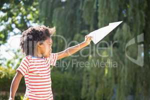 Boy is playing with a paper plane