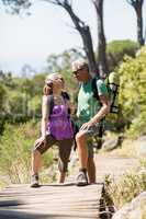 Couple smiling and looking each other during a hike