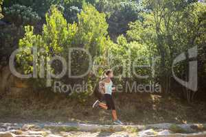 Distant view of woman jogging