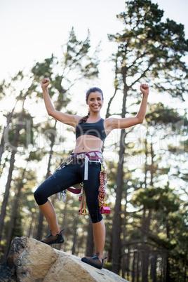 Woman succeed rock climbing