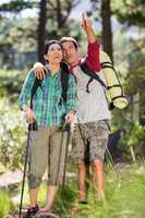 Couple pointing during a hike