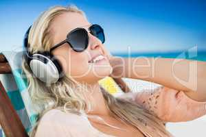Woman listening to music through earphones