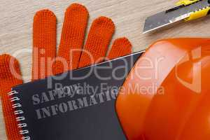 Industrial safety helmet, gloves and safety book