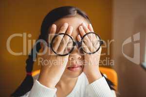 Schoolchild hiding her eyes