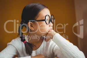 Schoolchild touching her chin