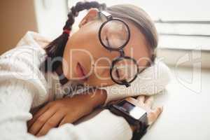Schoolchild sleeping on desk