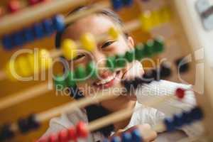 Schoolchild using a slide rule