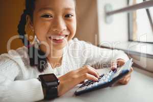 Schoolchild using a calculator