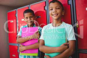 Boys standing in front of locker