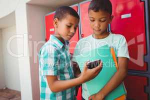 Boys with smartphone in the corridor