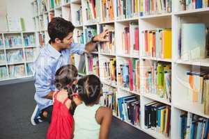 Kids selecting a book