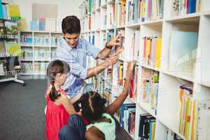 Kids selecting a book to read
