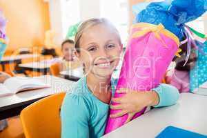 Portrait of a smiling pupil receiving a gift box