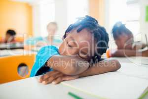 Pupil falling asleep at his desk