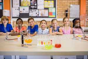 Students posing with chemical objects