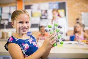 Child posing with an atom