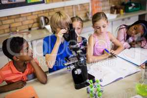 Children looking in microscope