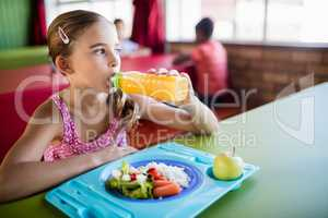Child drinking at the canteen