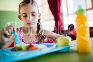 Child eating at the canteen